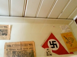 Display case of news clipping, family photos, and WWII memorabilia