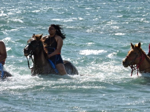 Riding horses in the ocean  grand turk
